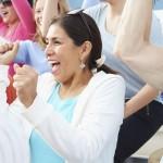 woman in aluminum bleachers cheering
